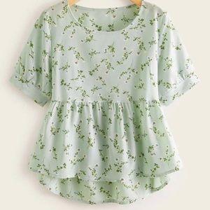 Spring printed dip hem peplum blouse